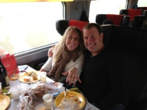 The couple eats a gourmet picnic on our TGV ride to Burgundy. Check out that ring!